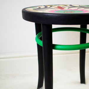 bentwood stool painted professionally refinished in black and bright green paint.