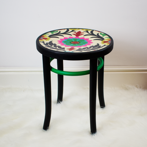 Vintage bentwood stool refinished in Matt black and bright green paint with boho print seat.