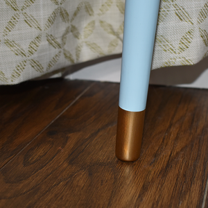 MCM teak coffee table, view of tapered leg painted light blue with painted gold caps.