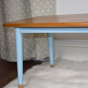 MCM teak coffee table, tapered legs, professionally refinished in light pecan stain and Autentico Bleu Clair paint. Mid century mod.