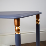 Large table from set of 3. Blue-grey with copper accents on the legs.