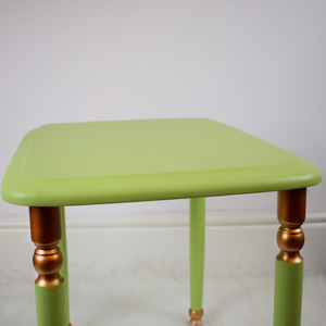 Medium table from set of 3. Light lime green with copper accents on the legs.