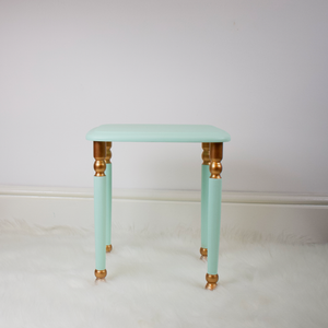 Small table from set of 3. Mint green-blue with copper accents on the legs.