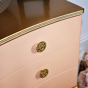 Vintage bedside table, inward curved drawers painted peach with a gold table top