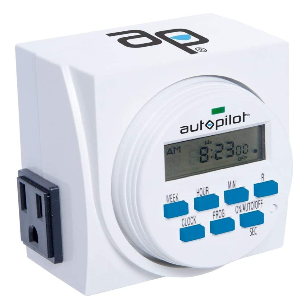 Closeup of Digital Wall timer showing front panel and plug on the side. White background