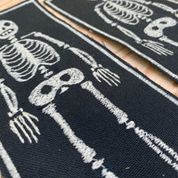 Freehand embroidered skeleton patch by artist Louis Bicycle