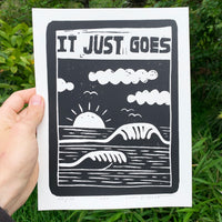 "Screen printed poster by artist Louis Bicycle. Ocean waves, sun, clouds. Text, ""It just goes."""