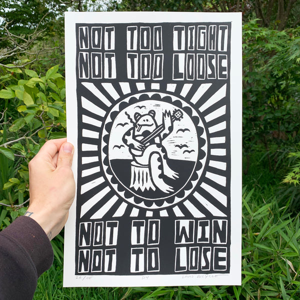 "Screen printed poster by artist Louis Bicycle. Frog playing banjo. Text ""Not too tight, not too loose, not to win, not to lose."""