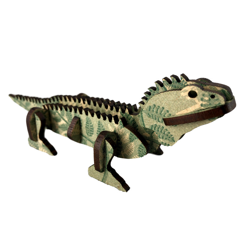 A wooden model of a native NZ tuatara