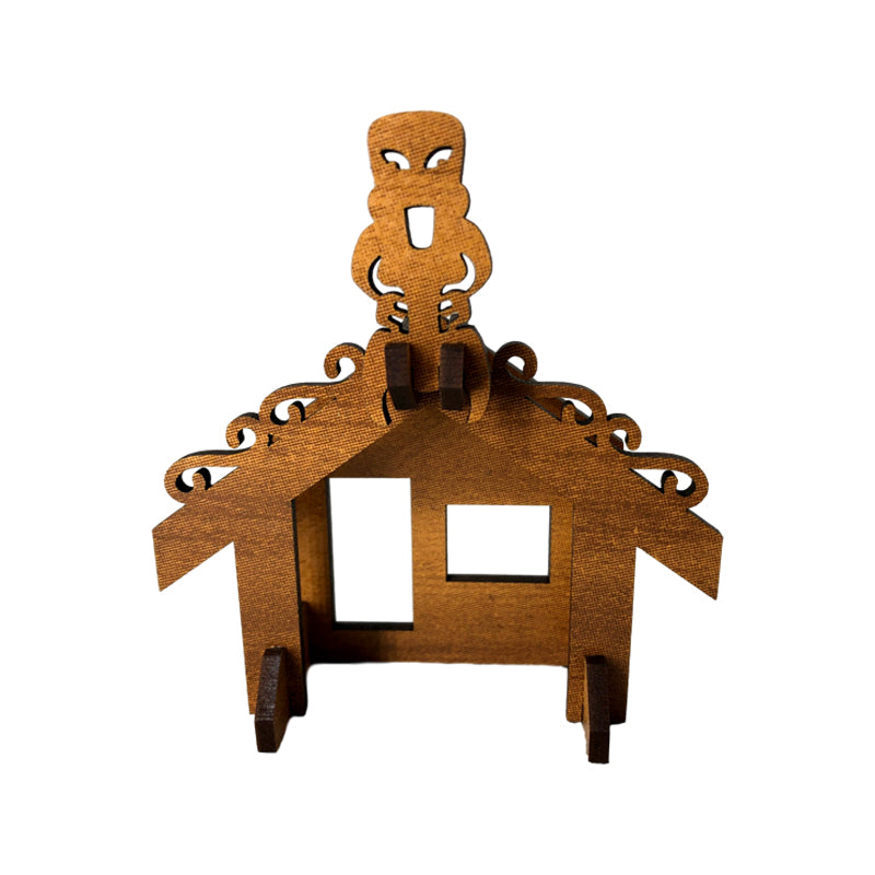 A wooden model of a traditional māori greeting house - a wharenui