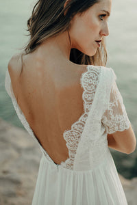 Young woman wearing the beach dress by Luna Bride.