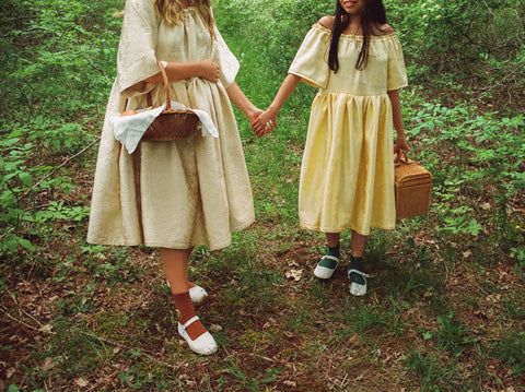 bekah and rachel in the woods with picnic supplies