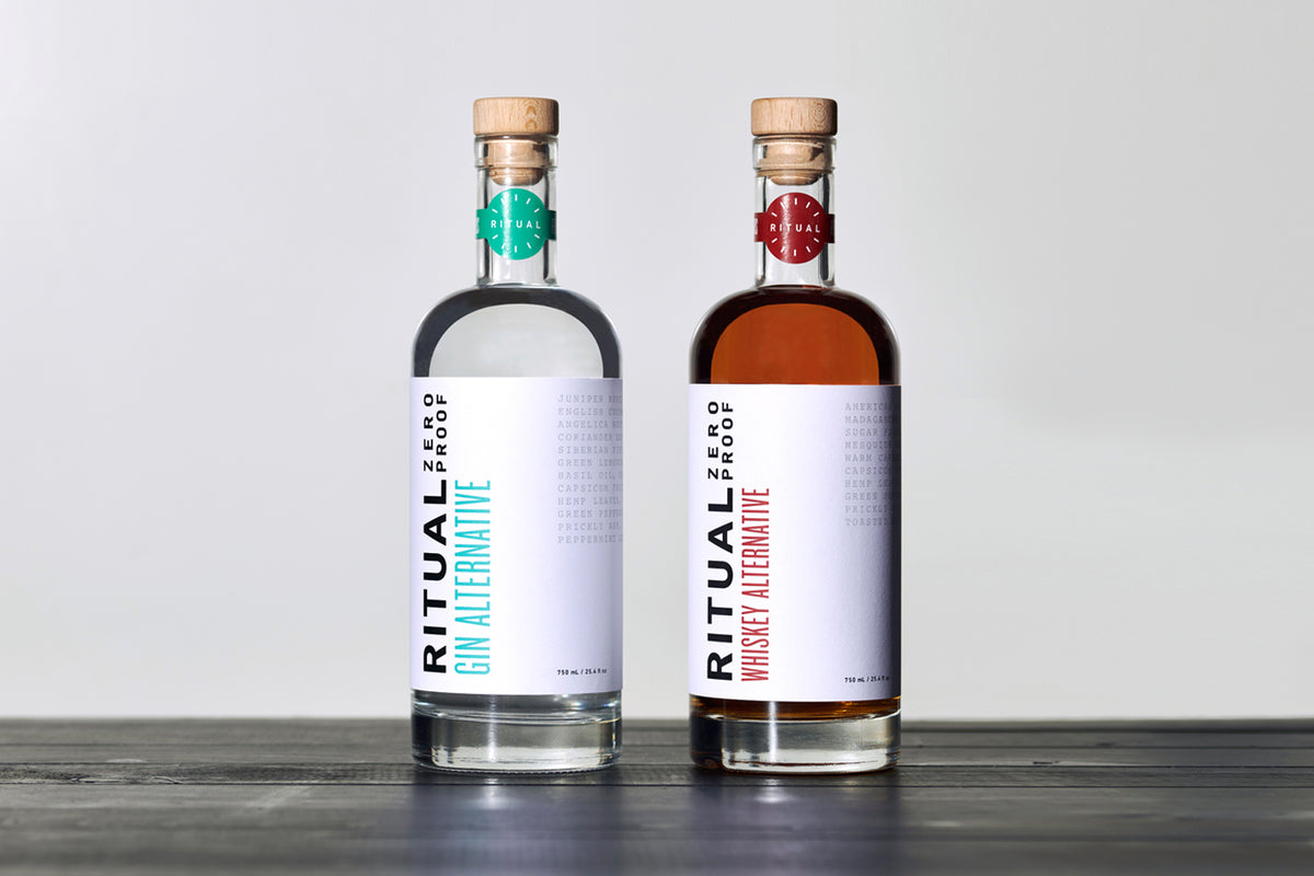 Two bottles of Ritual non-alcoholic gin and whiskey alternatives standing next to each other.