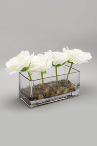 White Artificial Roses In Glass Pot