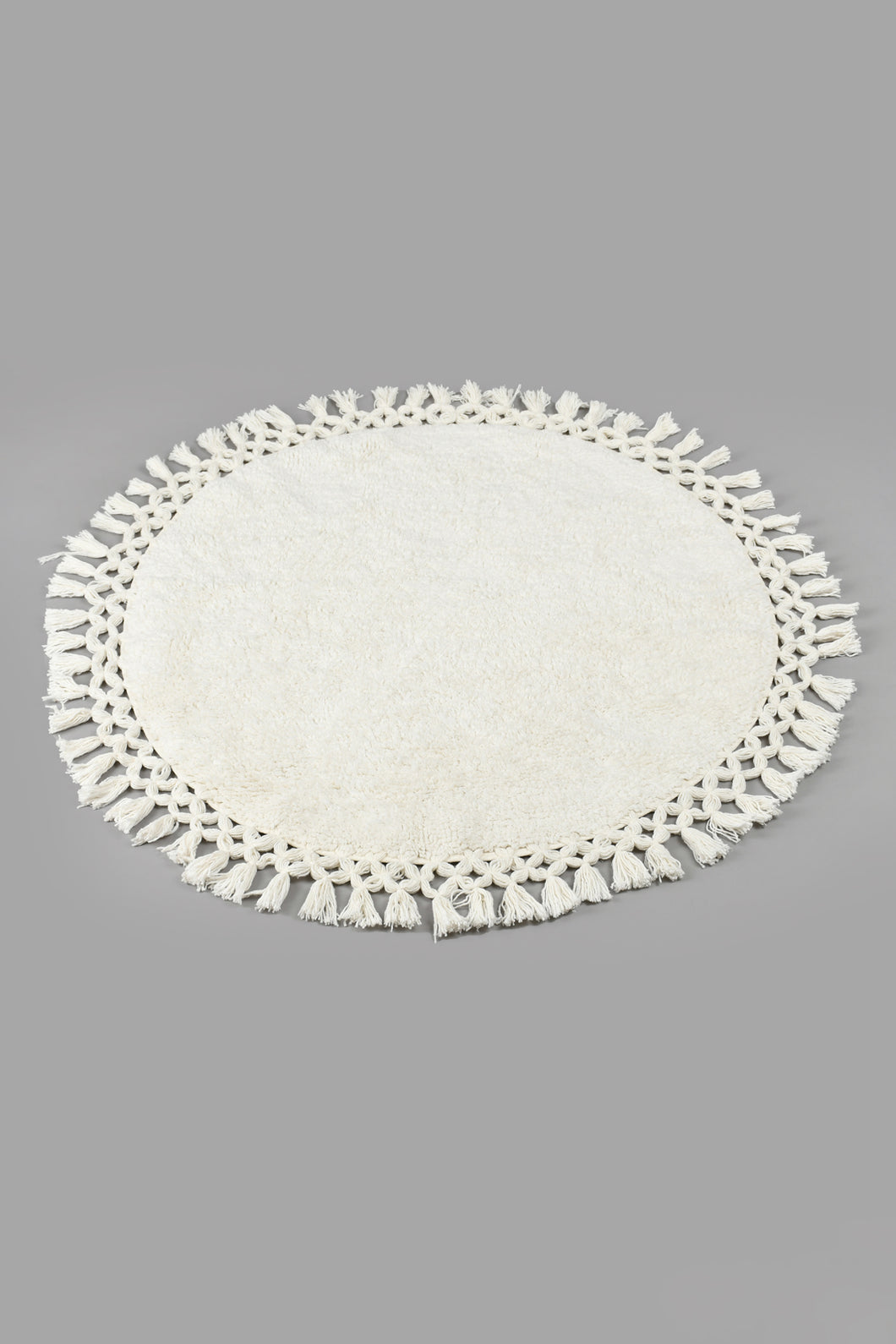 Ivory Tufted Round Rudf With Fringes