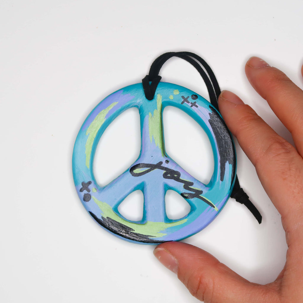 """Joyful Snow"" Handpainted Ceramic Peace Sign Ornament"