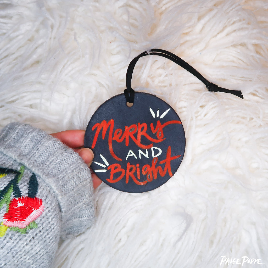 """Merry and Bright"" Handpainted Leather Ornament"