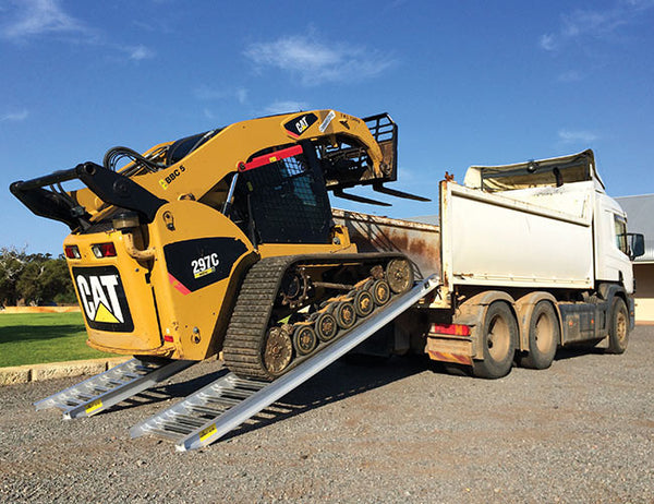 Secure transportation of skid steers with Himac Loading Ramps