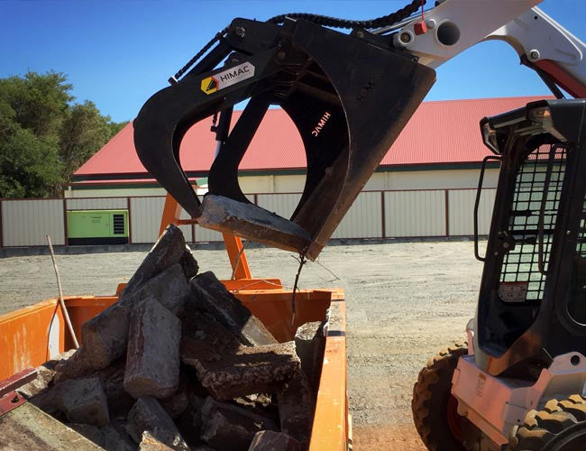 Grapple arms allow precise picking with your Skid Steer