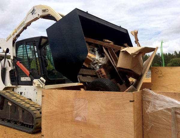 Easy unloading with the Skid Steer Skip Bin Bucket
