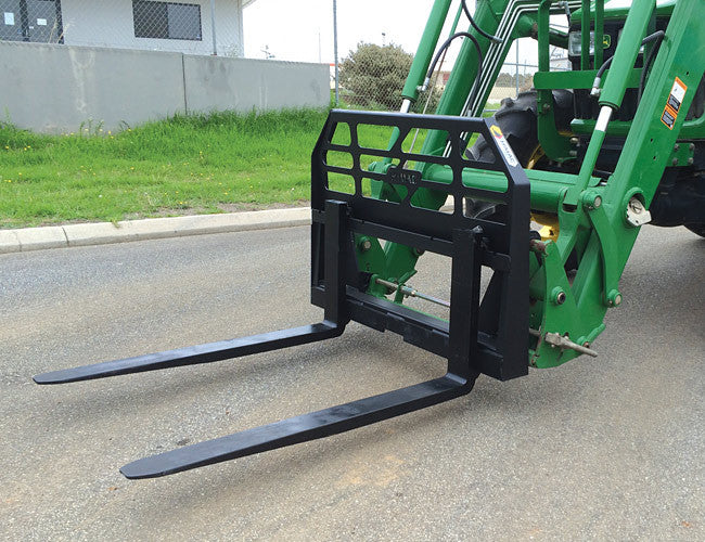 Pallet Forks for Tractor Loaders - sliding latch-locked tynes