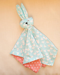 Bunny - Baby blue swans with peach and white crosses