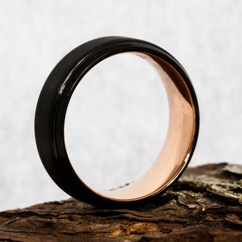 plated wedding ring on piece of wood