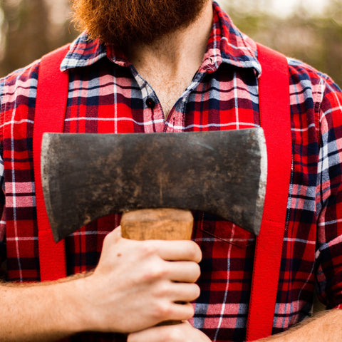 man holding ax in plaid shirt
