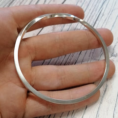 Solid silver continuous twist bangle