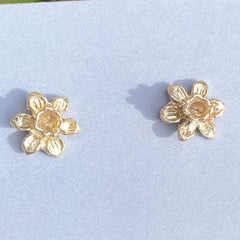 Tiny daffodil stud earrings in solid gold