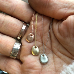 Solid gold pebble necklace with a diamond,  cast from a tiny real English pebble.