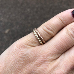 Solid rose gold twist ring