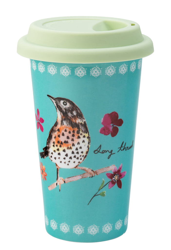 Teal mug with a pale green lid. A drawing of a bird on a branch