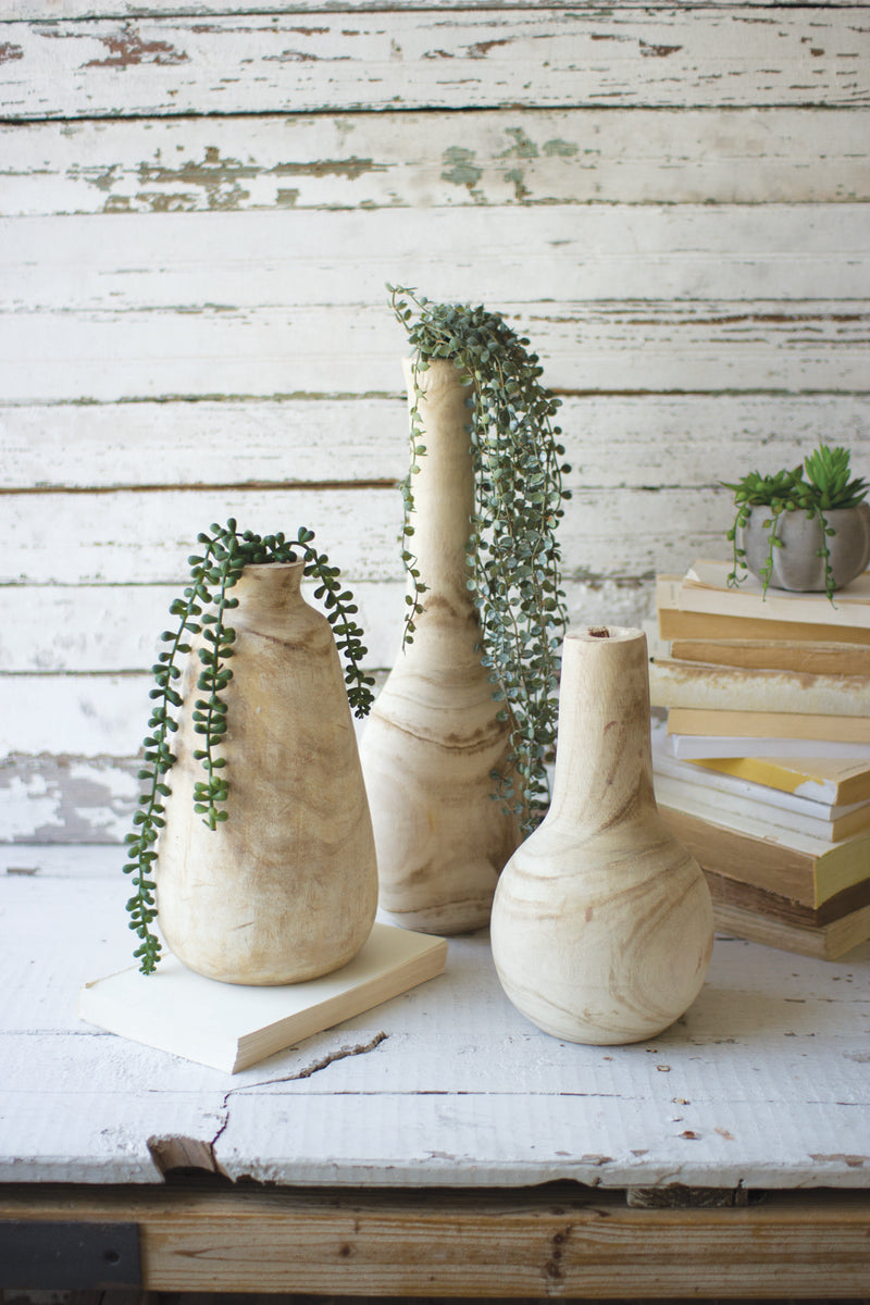 SET OF THREE HAND CARVED TALL WOODEN BOTTLES