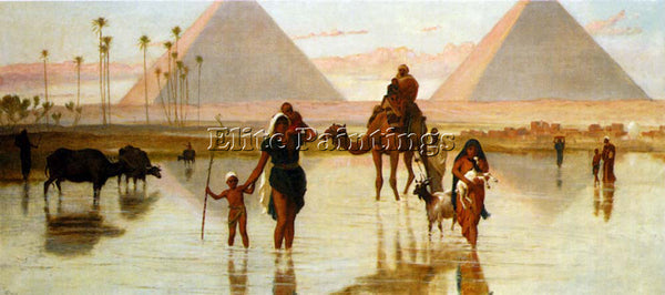 FREDERICK GOODALL ARABS CROSSING A FLOODED FIELD BY THE PYRAMIDS ARTIST PAINTING