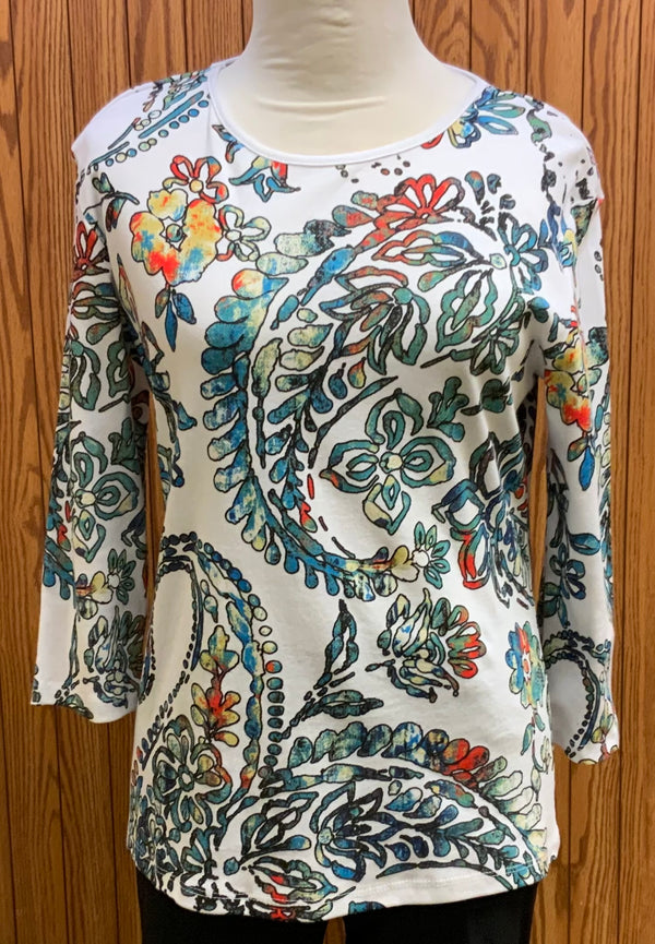 Charity Top | 3/4 sleeve  White background with blues, teals, black, orange, and beige all over print  100% preshrunk cotton  Machine washable  Made in the USA  Small - 3X