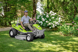 The GRILLO MD 22N Hydrostatic lawn mower being used by a man in his garden