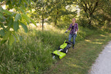 The GRILLO GF1 Sickle bar grass trimmer being used by a lady wearing safety gloves and boots