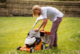 STIHL RMA 443C Walk Behind / Push Mower being emptied of grass by a lady