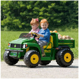 John Deere HPX children's electric gator in green and yellow trim and seat. Two young children driving the gator around.