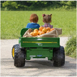 John Deere HPX children's electric gator in green and yellow trim and seat. Rear view as two young children drive away in the toy Gator