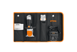 Image shows the STIHL HSA 25 case open with all components of the kit placed in their corresponding compartments