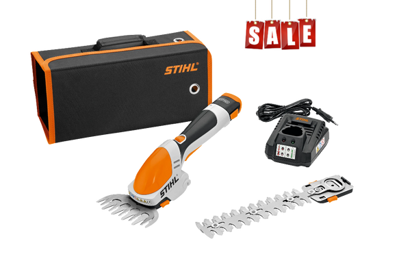 STIHL HSA 25 Battery Powered Shrub Shears. Image shows the components of the kit - grass trimmer, shrub shears, a charger and carry case in black with orange trim
