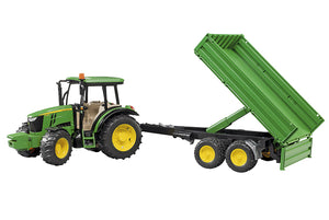 The John Deere 5115M toy tractor with tipping trailer in classic John Deere green