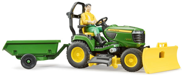 John Deere Lawn Tractor and Gardener Children's Toy showing the toy model on the tractor that is pulling a trailer
