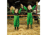 Two young girls playing in hay wearing the John Deere children's overalls in green