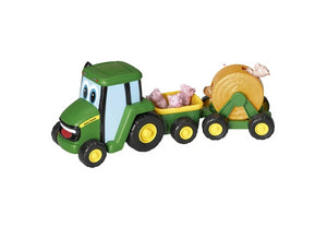 John Deere Country Fair Wagon children's toy, showing a miniature John Deere toy tractor with trailers pulling pigs and a hay bale