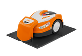 STIHL RMI 422 P Orange Robotic Mower in docking station where it charges