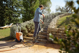 The STIHL RE 110 Pressure Washer being used by a man in his garden to clean steps