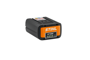 Product image of the STIHL AP 300 Battery. The image is black with an orange front. The image shows the LED light indicator that the product features
